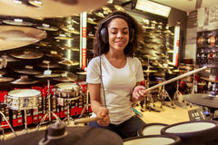 Woman playing electronic drums Royalty Free Stock Photography