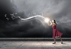 Woman playing fife Stock Image