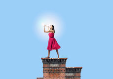 Woman playing fife Royalty Free Stock Images