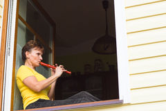 Woman playing  flute Royalty Free Stock Images