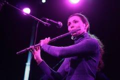 Woman playing flute Stock Photo