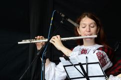 Woman playing the flute celtic medieval music in traditional scottish clothes Royalty Free Stock Photos
