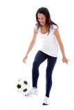 Woman playing football Royalty Free Stock Photo