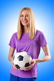 Woman playing football Stock Images