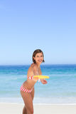 Woman playing frisbee royalty free stock photography