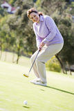 Woman Playing A Game Of Golf Stock Image