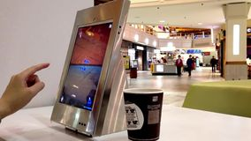 Woman playing game inside shopping mall stock video footage