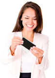 Woman playing games in her phone Stock Image