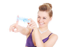 Woman playing with garter Stock Photography