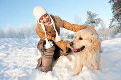 Woman playing with golden retriever outdoors Stock Photography