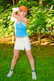 Woman playing golf Stock Images