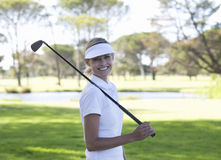 Woman playing golf royalty free stock image