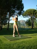 Woman is playing golf. A girl or woman is preparing to shoot Stock Photos