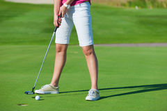 Woman playing golf Royalty Free Stock Photos