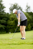 Woman is playing golf on course  summer Stock Images