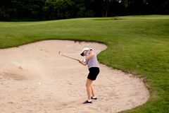 Woman is playing golf on course  summer Stock Photography
