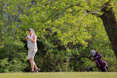 Woman playing golf. Royalty Free Stock Photography