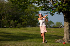 Woman playing golf. Stock Image