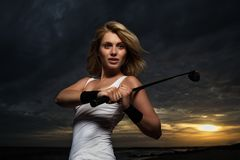 Golf player. Woman playing golf on a evening Stock Photos