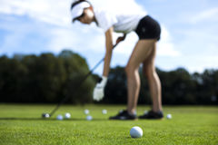 Woman playing golf on field. Bright colorful vivid theme Royalty Free Stock Image