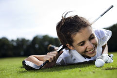 Woman playing golf on field. Girl playing golf on grass in summer Royalty Free Stock Photo