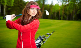 Woman playing golf on a green Stock Photo