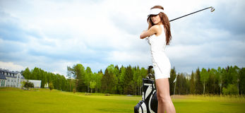 Woman playing golf on a green Stock Images