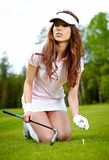 Woman playing golf on a green woman Royalty Free Stock Image