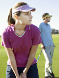 Woman Playing Golf With Male Friend Royalty Free Stock Image