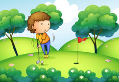 A woman playing golf at the top of the hill Stock Photos