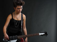 Woman playing guitar. Portrait of young woman playing guitar (with copy space for your text and etc Royalty Free Stock Photography