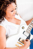Woman playing guitar Stock Photography