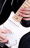 Woman playing on guitar Royalty Free Stock Photo