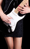 Woman playing on guitar stock images