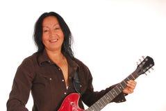 Woman playing a guitar Stock Photos