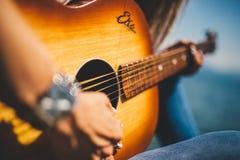 Woman playing guitar Stock Image