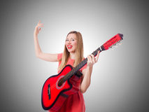 Woman playing guitar against the gradient Royalty Free Stock Images