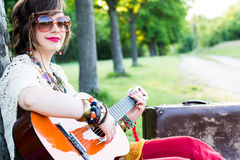 Woman playing guitar Stock Photos