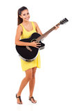 Woman playing guitar Stock Image