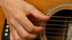 Woman playing guitar close up stock video footage