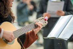 Woman playing guitar Royalty Free Stock Photography