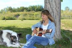 Woman Playing the Guitar Stock Photos