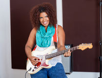 Woman Playing Guitar In Recording Studio Stock Image