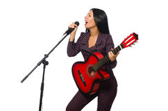 The woman playing guitar and singing isolated on Stock Image