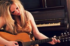 A woman playing the guitar royalty free stock photos
