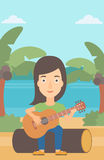 Woman playing guitar. Royalty Free Stock Photos
