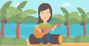 Woman playing guitar. Royalty Free Stock Photography