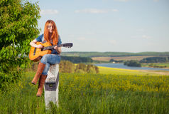 Woman playing guitar Royalty Free Stock Photo