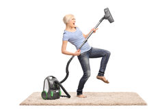 Woman playing guitar on vacuum cleaner Stock Photos