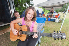 Woman Playing Guitar at the Wild Goose Festival Royalty Free Stock Image